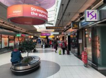 How to get from Schiphol airport to Amsterdam center?